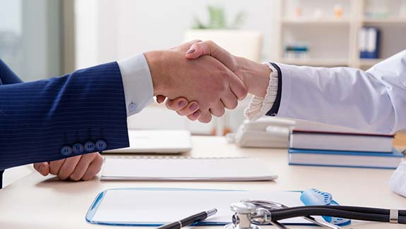 doctor and buissness man shaking hands